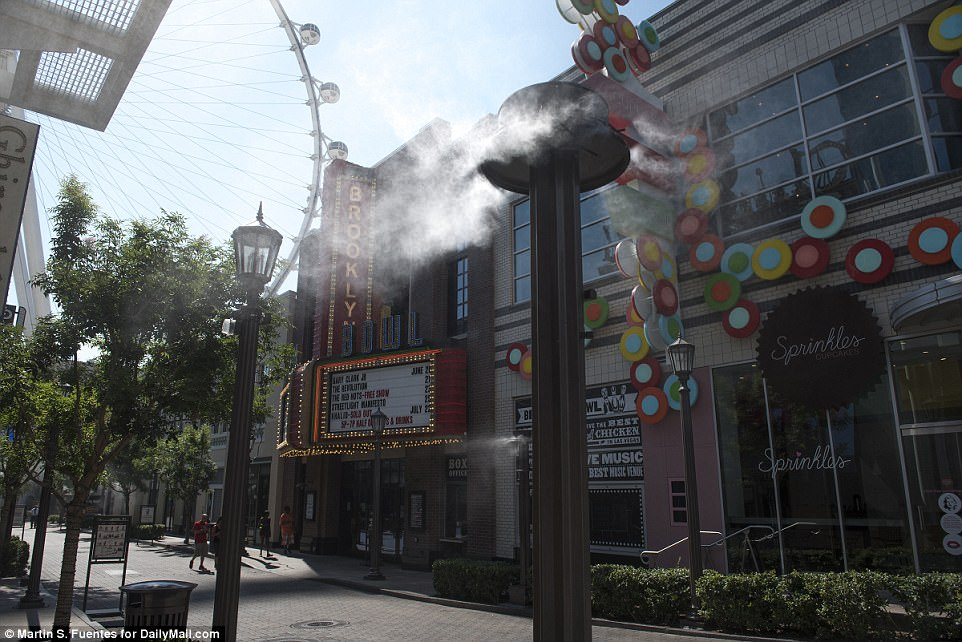 Usually during the summer months the streets of Las Vegas can be seen packed with tourists, but Tuesday only a few people were spotted out in the heat. Above misters are seen at the Linq Promenade to keep patrons cool from the hot temperatures in Las Vegas