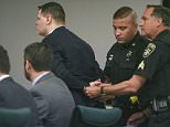 Guilty: Washington County Sheriff's Officers place handcuffs on Matthew Slocum, 29, after he was found guilty on all counts in his triple murder retrial on Tuesday