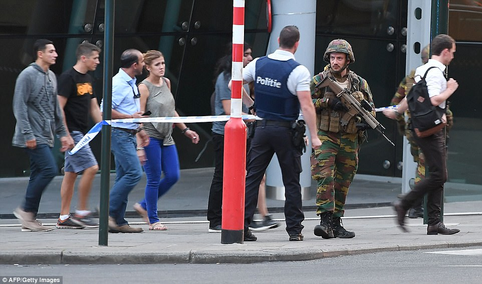Panicked members of the public were rushed away from the scene of the blast on Tuesday night