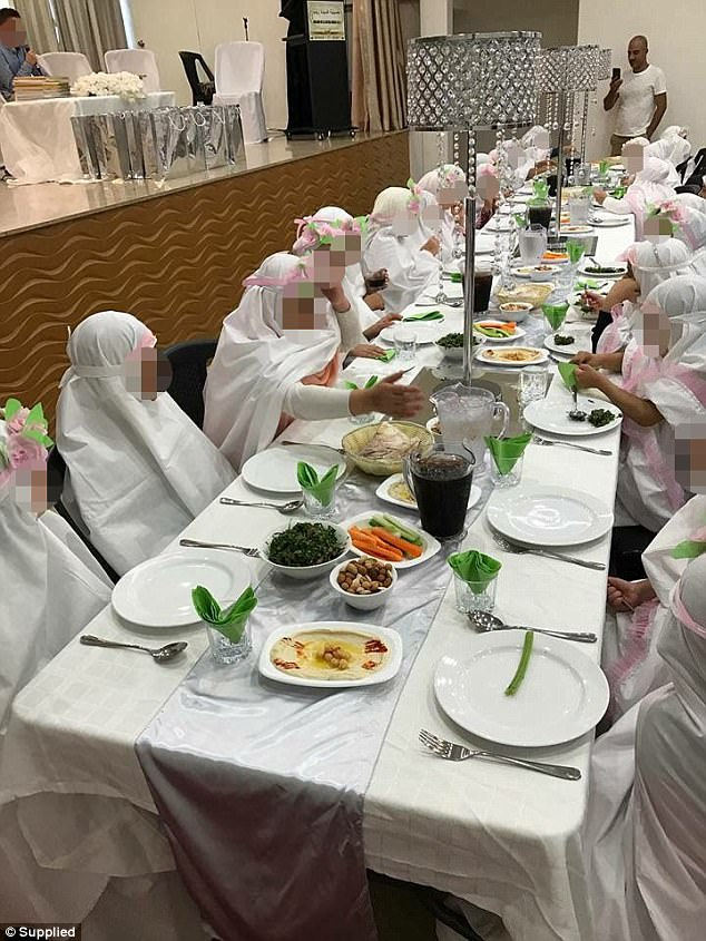 The girls at Banksia in Sydney's south-east have dinner at a ceremony to mark maturity