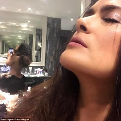Sexy:Salma Hayek put on a far raunchier display for her fans on Wednesday, as she shared a stunning selfie on Instagram - which flashed her topless frame