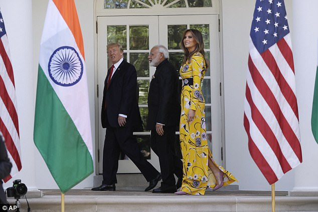 Trump led the way into the White House with Modi, who wore a jet black Nehru collar suit, following close behind alongside Melania
