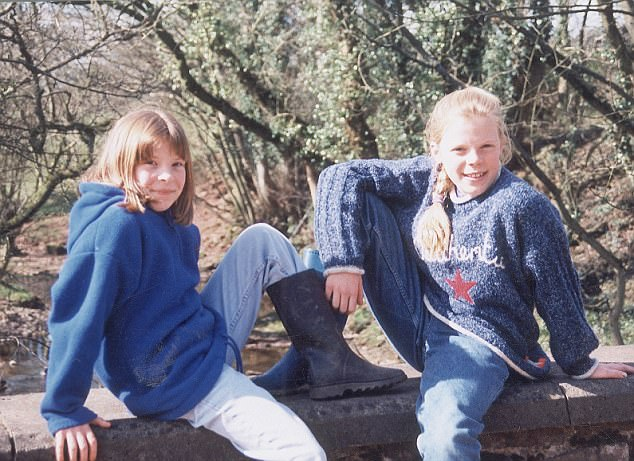 Milly Dowler (left) and her sister Gemma (right) were photographed sat on a wall during a holiday to Brecon, Wales