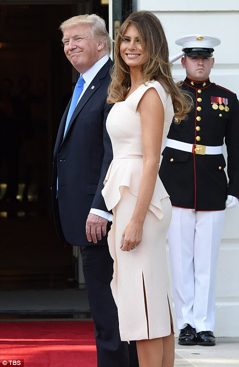 She appeared to be in high spirits, as did the president, as they waited for their guests