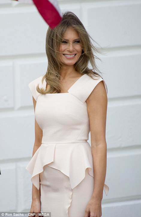 Both the president and the first lady were in high spirits as they waited for their guests on the South Lawn entrance