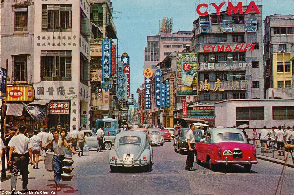 Even back in 1962, the roads were populated with cars but there are no skyscrapers to block out the sky, and no road markings
