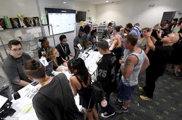 Customers flooded into the Essence dispensary to examine the wares and buy up to an ounce of marijuana legally