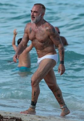 Chilling:Not one to be shy about showing off his impressive frame, the silver fox ensured that all eyes were on him as he slipped into a skin-tight pair of white Speedos