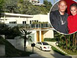 Pictured is Melanie B's house in the Hollywood Hills, Los Angeles that is estimated at $3 million. The former 'Spice Girl', also known as 'Scary Spice', has just had a rooftop completed with lounge chairs and umbrellas, with her white Mercedes sports car parked outside. <P> Pictured: Melanie Brown's House, Hollywood Hills, Los Angeles <P> <B>Ref: SPL167512  260310  </B><BR/> Picture by: Splash News<BR/> </P><P> <B>Splash News and Pictures</B><BR/> Los Angeles:310-821-2666<BR/> New York:212-619-2666<BR/> London:870-934-2666<BR/> photodesk@splashnews.com<BR/> </P>