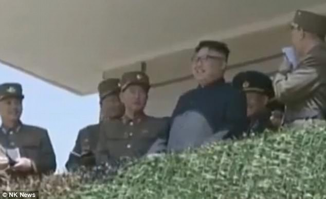 The tyrant could be seen grinning as special forces soldiers used grenades to blow up a replica Hyunmoo-3 cruise missile