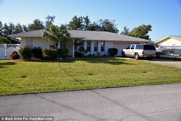 Before: This was how the couple's house was when they won the lottery - but they did not move to a lavish new spread or spent their fortune on cars and yachts. They still have the same boat and have simply upgraded to a new SUV