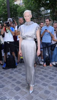 Stunning in silver: Tilda Swinton was once again daring to be different when she attended the Vogue Party during Paris Haute Couture Fashion Week 2017 on Tuesday