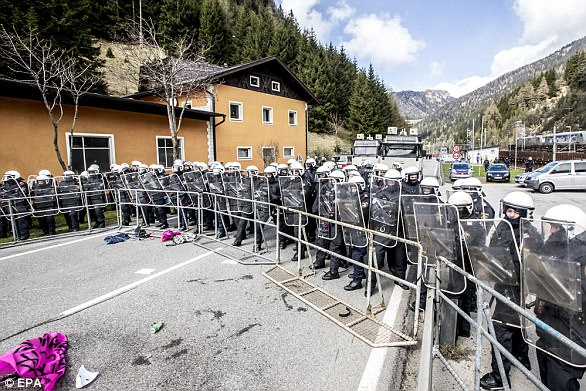 Austria is sending 750 troops to its southern border with Italy in order to head off an expected influx of migrants (pictured, riot police face off against protesters over the last time border checks were imposed)