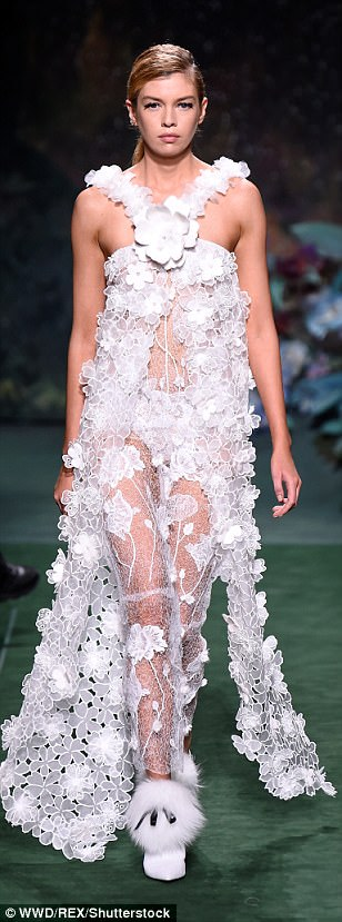 Bridal chic: Stella Maxwell (left) and other models sported white lace numbers on the runway