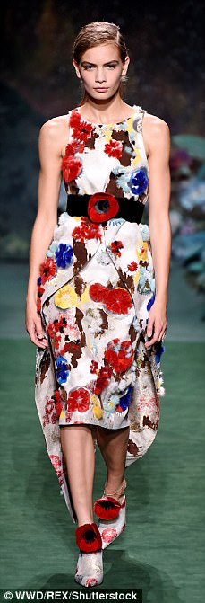 Rainbows hues: Models rocked beautiful, floral applique dresses with caped overlays and floaty skirts