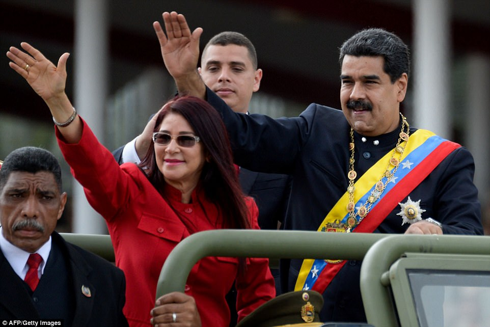 Image result for Venezuelan President Nicolas Maduro and First Lady Cilia Flores wave