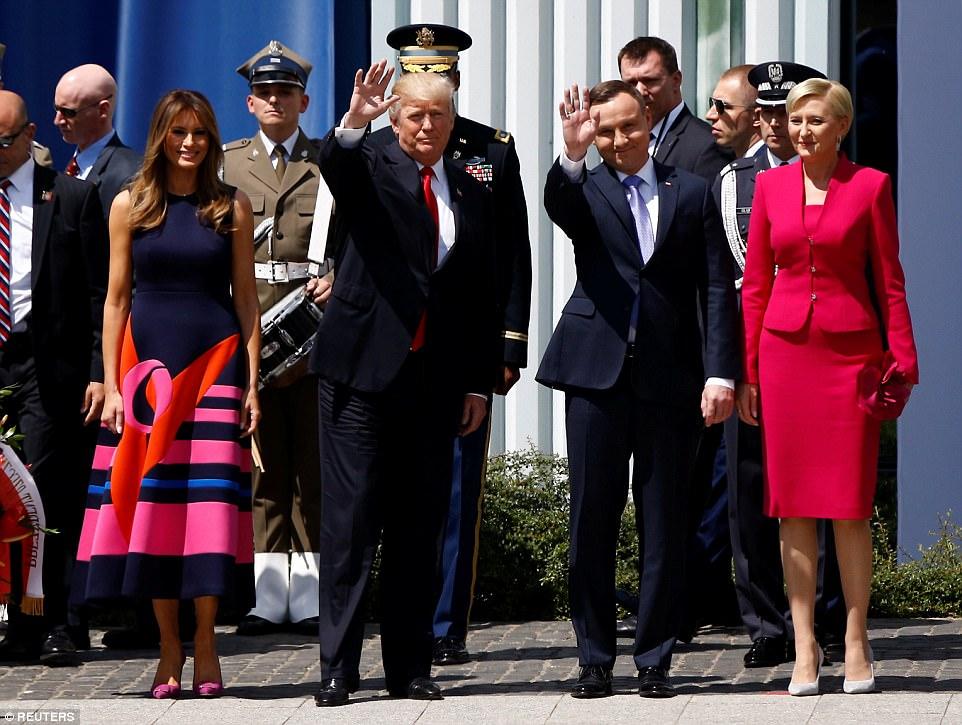 Trump waves next to First Lady of the US Melania Trump, Polish President Andrzej Duda and First Lady of Poland Agata Kornhauser-Duda before Trump's public speech at Krasinski Square