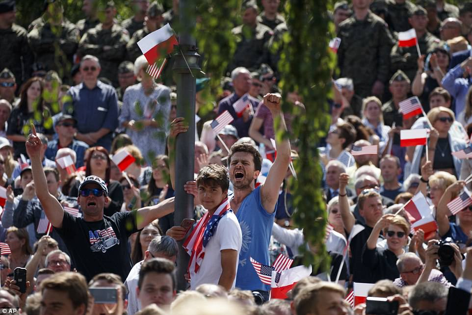 People cheer as Trump delivers his landmark speech at Krasinski Square at the Royal Castle