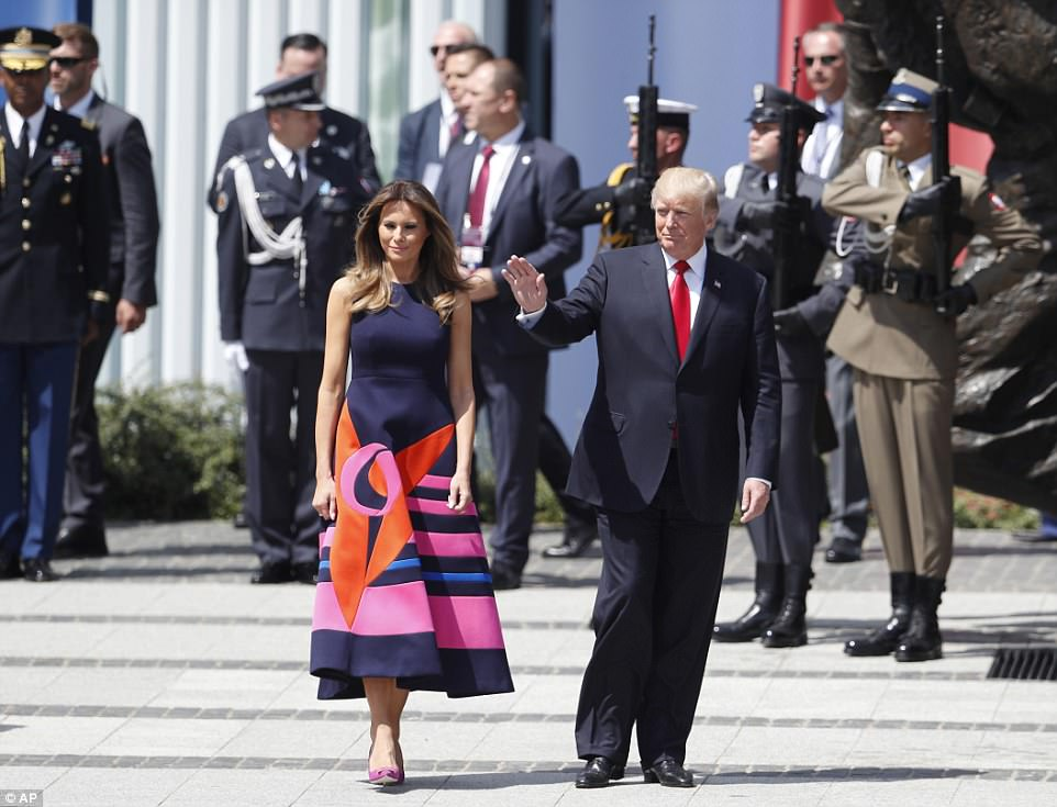 First Lady Melania walked alongside President Trump as they arrived at Krasinski Square on Thursday ahead of Trump's speech