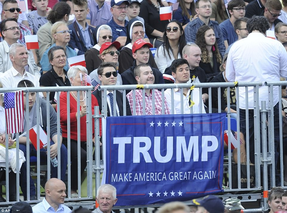 Some Trump supporters tied a 'Make America Great Again' banner to a barrier fence ahead of the speech. Nearby attendees wore hats bearing the same slogan