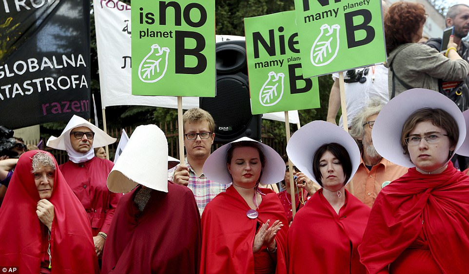 Poland has month the tightest abortion laws in Europe, and a proposal last year sought to ban all abortions unless a mother's life was at risk. Demonstrators at Thursday's protest wore pins that read 'Together' in Polish