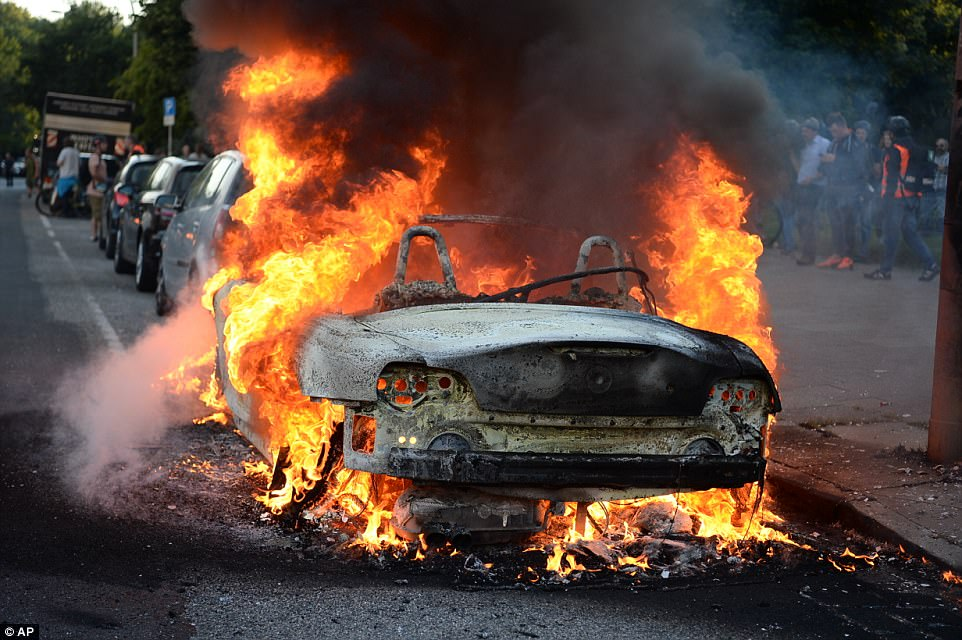 Pictured: A car burns during a protest against the upcoming G20 summit in Hamburg
