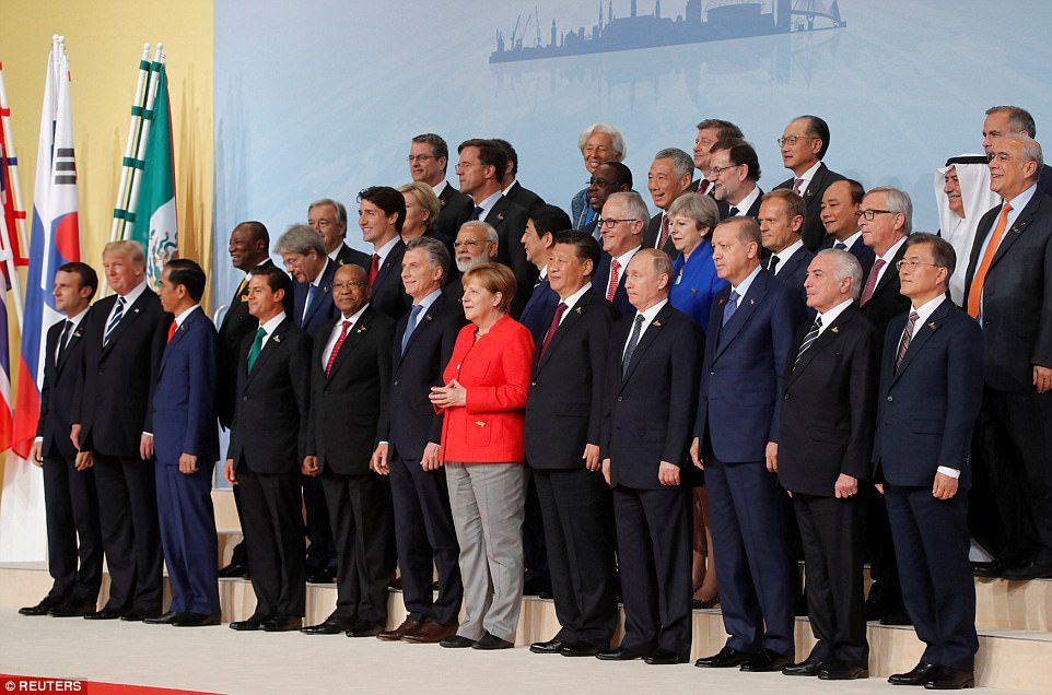 German Chancellor Angela Merkel takes part in a family photo along with French President Emmanuel Macron, U.S.President Donald Trump, Indonesia's President Joko Widodo, Mexico's President Enrique Pena Nieto, South African President Jacob Zuma, Argentina's President Mauricio Macri, Chinese President Xi Jinping, Russian President Vladimir Putin, Turkish President Recep Tayyip Erdogan, Brazilian President Michel Temer, South Korea's President Moon Jae-in, Italian Prime Minister Paolo Gentiloni, Canadian Prime Minister Justin Trudeau, India's Prime Minister Narendra Modi, Japanese Prime Minister Shinzo Abe, Australian Prime Minister Malcolm Turnbull, Britain's Prime Minister Theresa May, European Council President Donald Tusk, European Commission Jean-Claude Juncker, U.N. Secretary-general Antonio Guterres, Norway's Prime Minister Erna Solberg, Netherlands' Prime Minister Mark Rutte, Senegal's President Macky Sall, Singapore's Prime Minister Lee Hsien Loong, Spanish Prime Minister Mariano