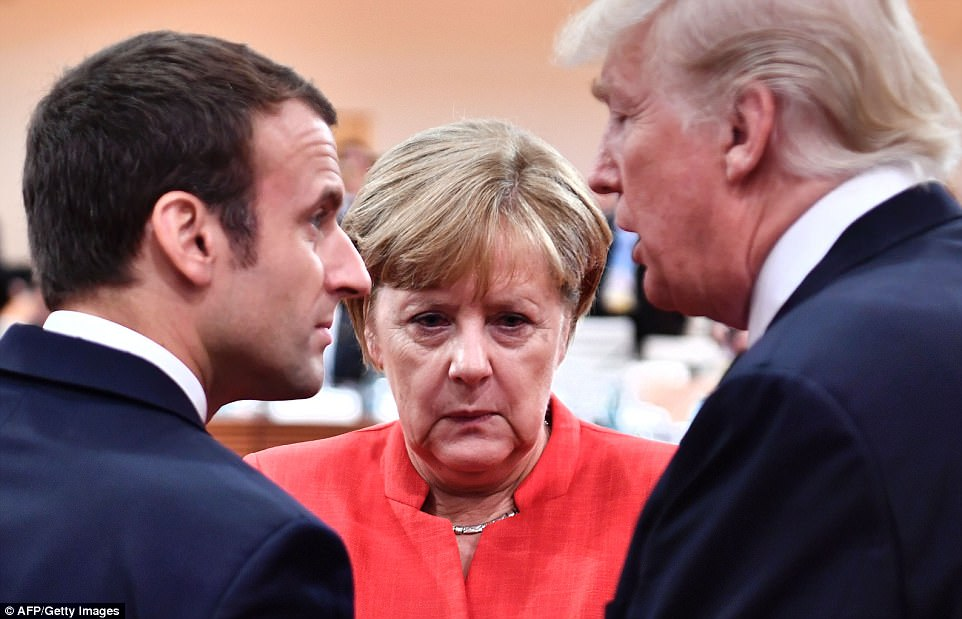 Mediator Merkel? The German Chancellor listens in as Macron and Trump exchange a few words