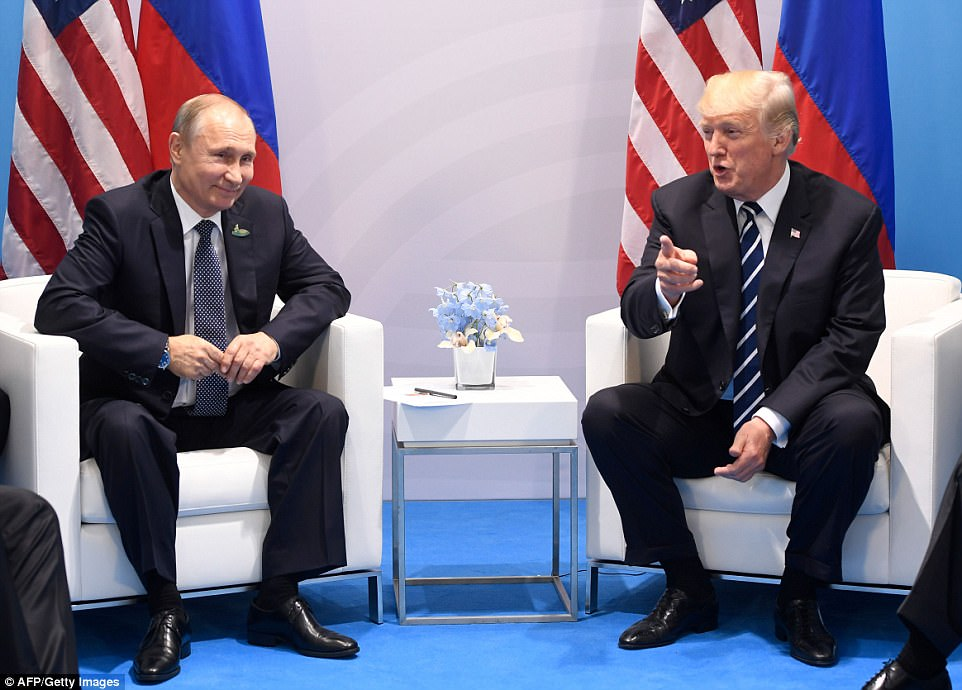 Thin smile: Putin appeared to come close to a grin as Trump made a point about reporters and photographers allowed into the start of their meeting