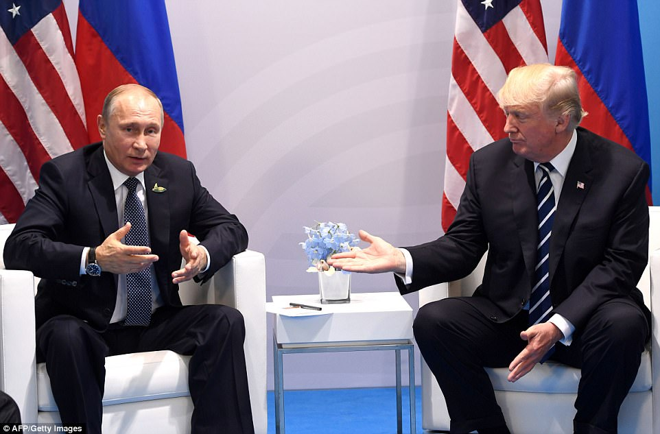 Putin does the talking: The Russian president said he was 'delighted' to meet with the U.S. leader