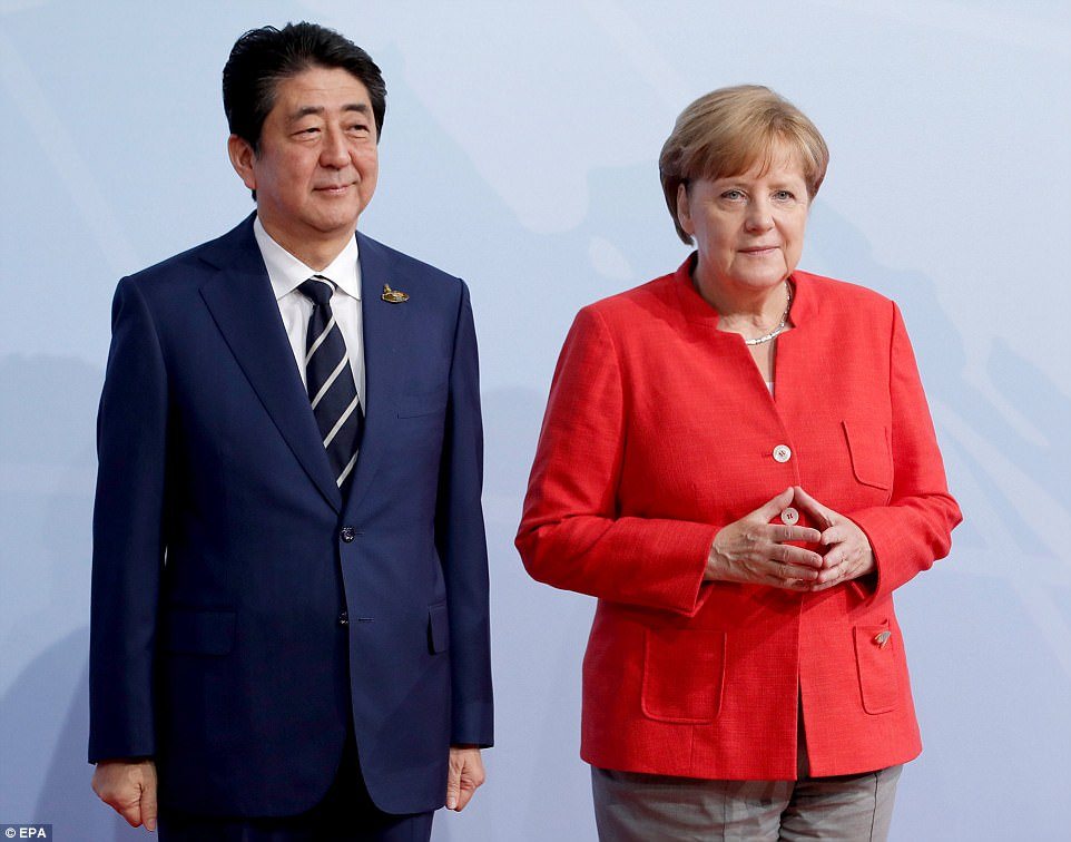 Merkel officially welcomes Japan Prime Minister, Shinzo Abe, to the opening day of the G20 summit. Japan and the European Union agreed a free trade pact on Thursday to create the world's biggest open economic area and signal resistance to what they see as Trump's protectionist turn