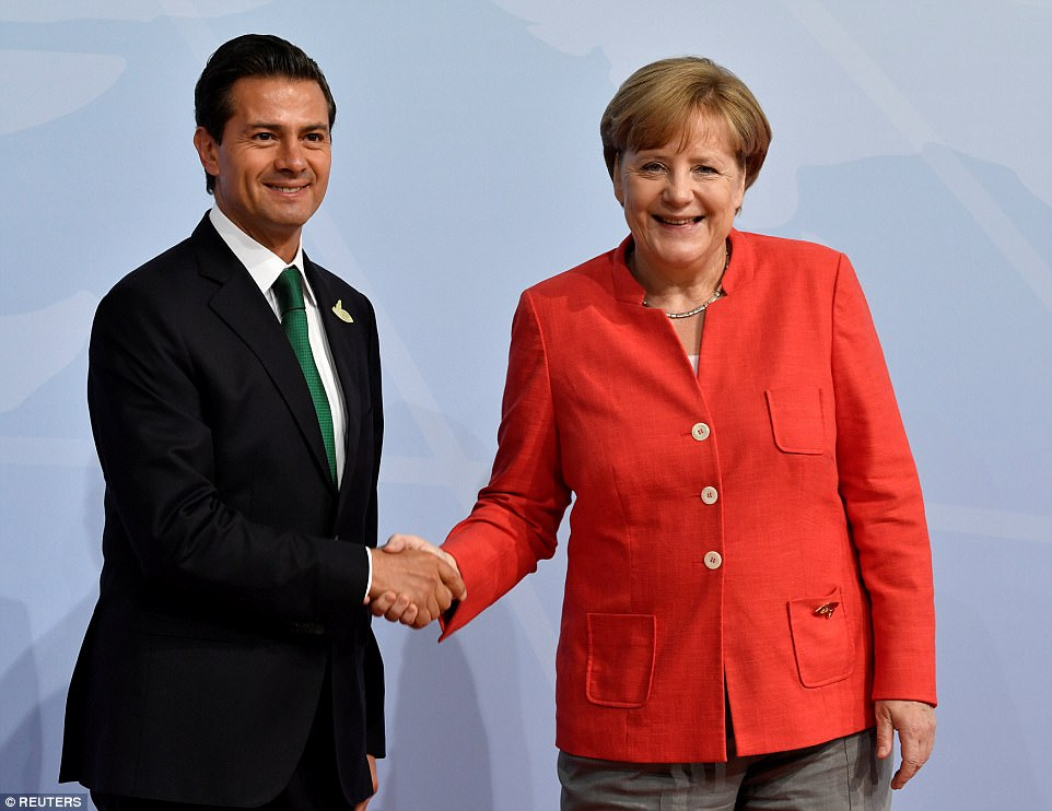 Merkel greets Mexico's President Enrique Pena Nieto at the beginning of the G20 summit. Pena Nieto will meet with Trump later during the two-day event