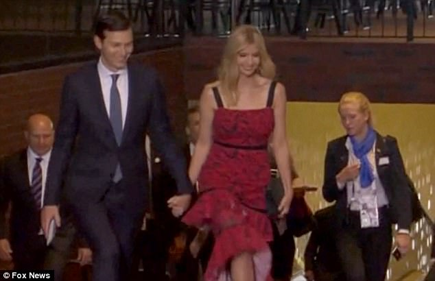 Lady in red: The pair were seen holding hands on Thursday night as well when they attended the opening night event at Elbphilharmonie concert hall (above)