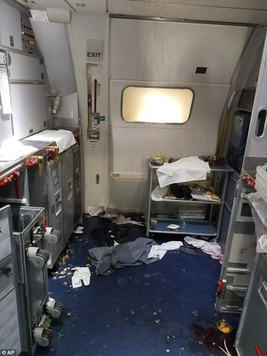 This Friday, July 7, 2017 photo taken by the FBI and released via the US Attorney's Office in Seattle shows the aftermath of a cabin fight on Delta Flight 129 from Seattle to Beijing