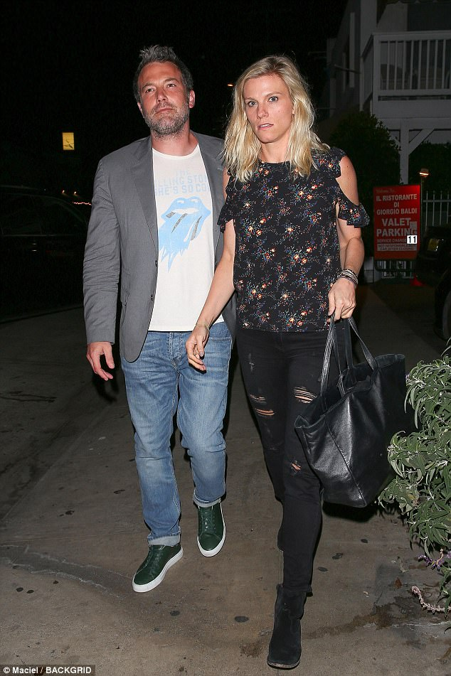 Happy: Ben Affleck was spotted with Saturday Night Live producer Lindsay Shookus for the first time while leaving their dinner date at Giorgio Baldi in Los Angeles on Thursday