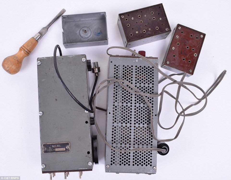 This 'biscuit tin' radio transmitter was used by a secret agent to receive messages behind enemy lines in occupied Belgium