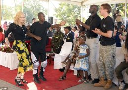 High spirits: Madonna was seen getting involved with the festivities at the opening