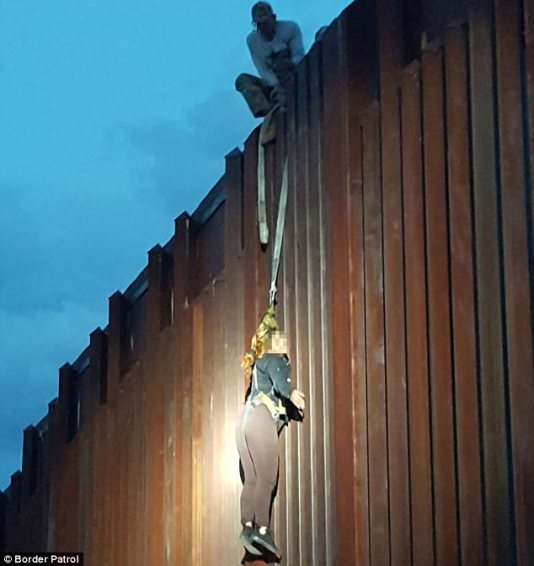 A 37-year-old Mexican woman was left hanging by people smugglers on the border wall at Nogales, Arizona, on Saturday
