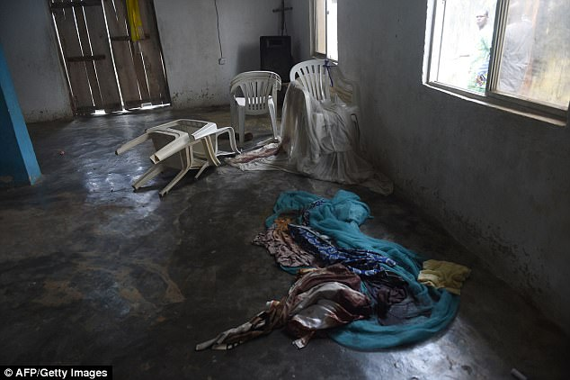 Pictured: Blood stained clothes on the floor in the church in Lagos