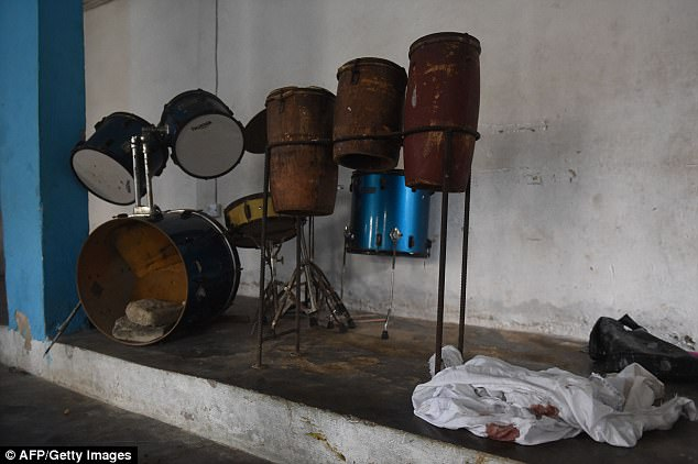 Pictured: Musical drums arranged in a corner beside the blood stained clothes of worshippers