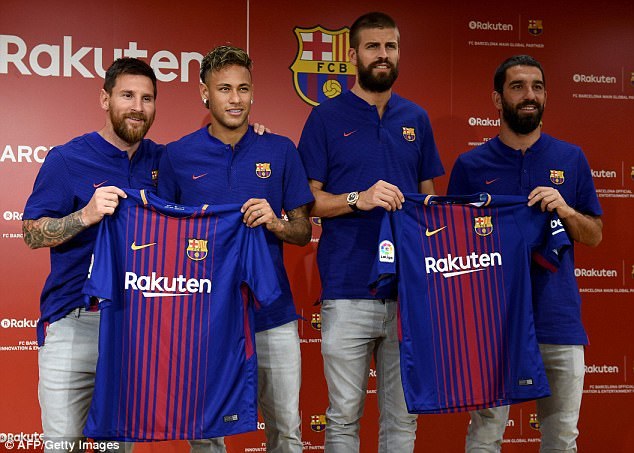 Lionel Messi, Neymar, Gerard Pique and Arda Turan (left-right) pose with the new home shirt