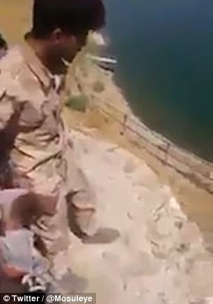 Pictured: The man - who it is claimed is an ISIS fighter - is brought to the precipice moments before he is executed