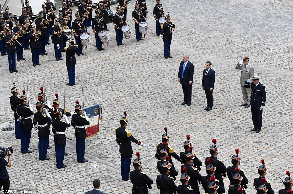 Hasil gambar untuk President Trump and First Lady Melania Trump participate in a tour of Les Invalides