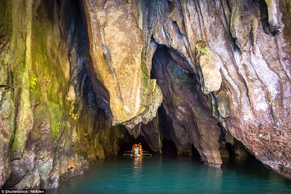 Action and adventure: As well as stunning waters, the archipelago is home to two Unesco World Heritage Sites, including the underground Puerto Princesa Subterranean River (entrance pictured)