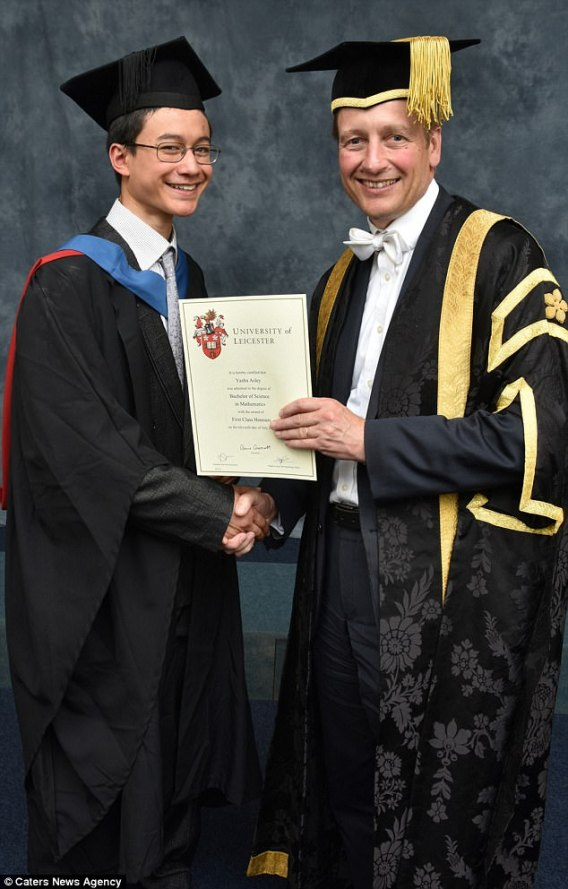 Yasha is presented with his certificate by President and Vice-Chancellor Professor Paul Boyle