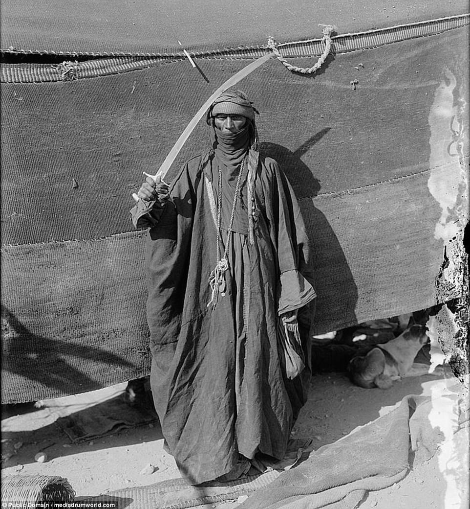 A Bedouin woman wielding a blade in preparation for a sword-dance at an unknown location between 1898 and 1914. The photos were taken in the deserts of North Africa and the Middle East