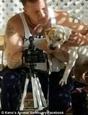 Giuliani cuddles a dog
