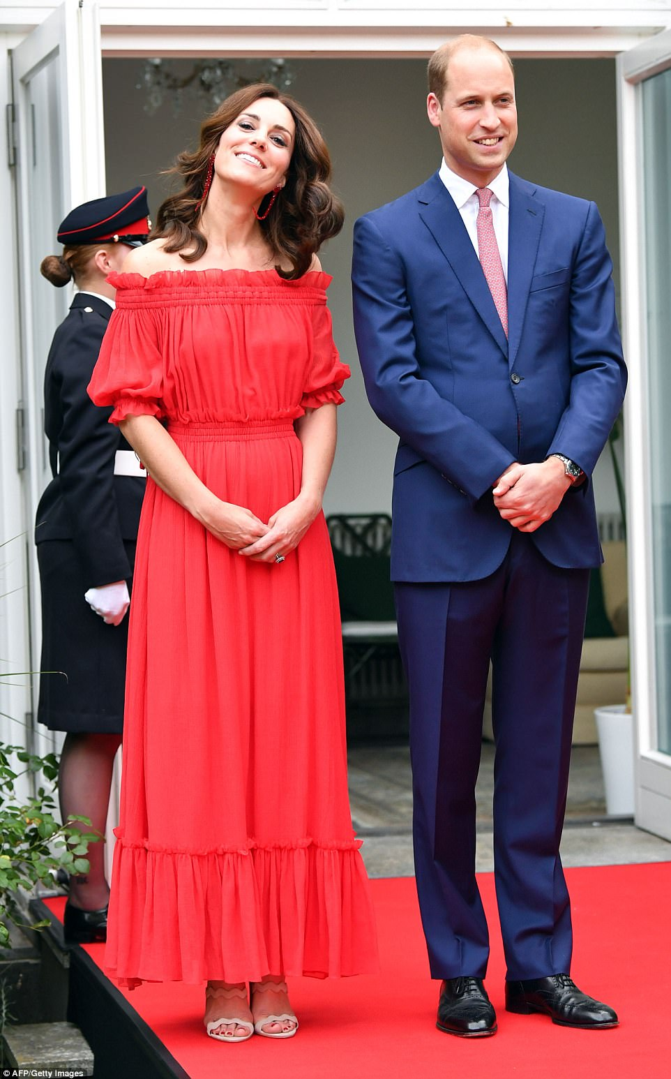 Smiling Kate looked to be in good spirits tonight as Berlin rolled out the red carpet for their VIP visitors. The couple both raised a toast to the Queen - in whose honour the party was thrown - as well as their hosts after giving his speech