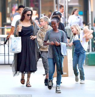 Protection:The Maleficent alum and her family were accompanied by two bodyguards, as well as a woman who appeared to be a nanny