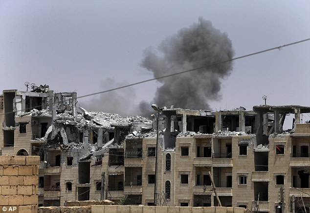Smoke rises from a coalition airstrike which attacked an Islamic State position, on the front line on the eastern side of Raqqa where the advances have slowed down